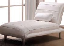 Sillón cama tapizado en piel